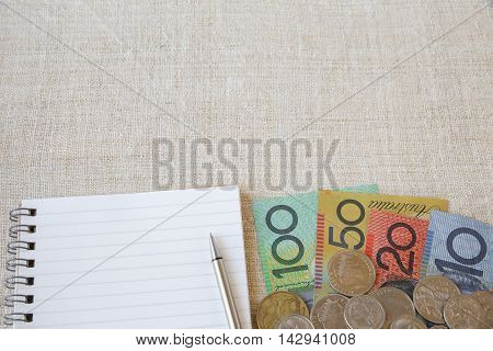 Australian Money, Aud With Notebook And Small Money Pouch, Copy Space Background