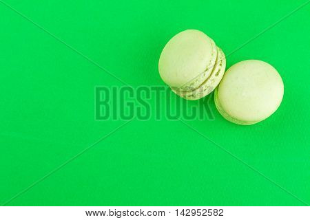 Two Green Cake Macaron On Green Background, Maccarone Sweet Dessert