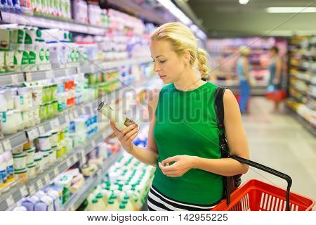 Woman Shopping Groceries At Supermarket.