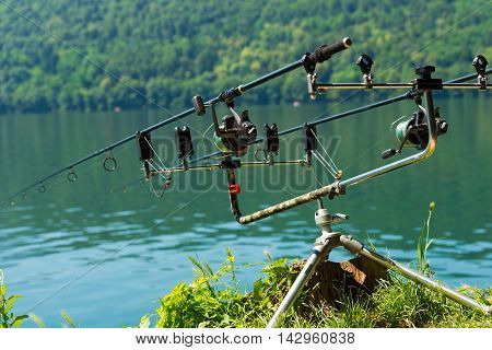 Professional equipment for carp fishing with two fishing rods with reel on a support system (rod pod) poster