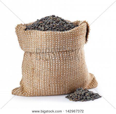 black beluga lentils in burlap bag with heap near isolated on white background. Black beluga lentils. Super food