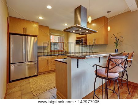 Small Kitchen Room Interior With Light Brown Cabinets And Tile Floor.