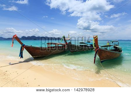long boats on Railay beach at Krabi Thailand, Traditional thai boats at the beach