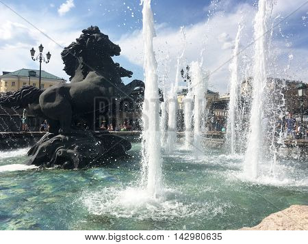 Moscow Russia - June 20 2015: Beautiful and elegant fountain with horses in Alexander gardens. in Moscow Russia Kremlin garden.
