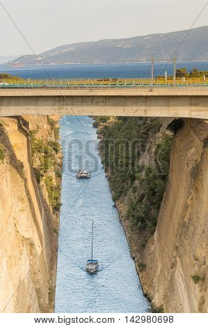 Boats travelling inside the isthmus of Corinth in Greece.
