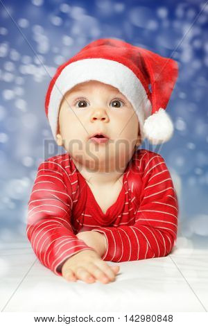 Baby on New Year snow sky background