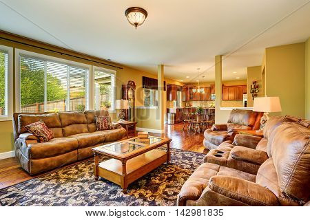 Luxury Living Room With Hardwood Floor And Kitchen View