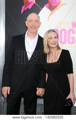 LOS ANGELES - AUG 15:  JK Simmons, Michelle Schumacher at the War Dogs