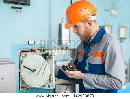 Young Engineer Working At Control Room
