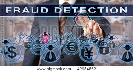 Civil or criminal investigator is touching the words FRAUD DETECTION on a transparent control screen. Forensic science and law enforcement concept. Cyber crime and deception metaphor.