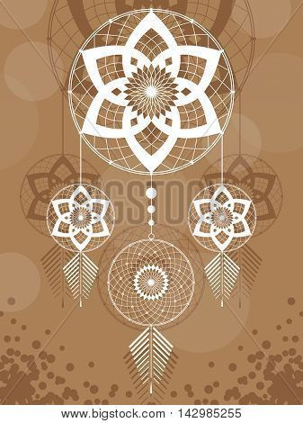 amulet of the Dreamcatcher from the three round elements and feathers on a brown background