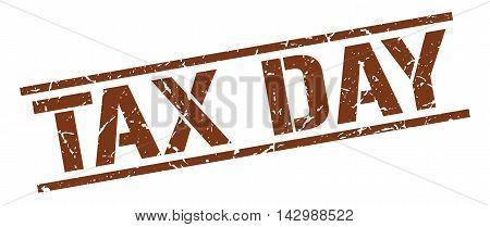 tax day stamp. brown grunge square isolated sign