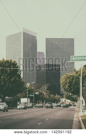 LOS ANGELES, UNITED STATES - DECEMBER 27: Traffic on a multi-lane road leading to the city center of Los Angeles with different skyscrapers on December 27, 2015 in Los Angeles.