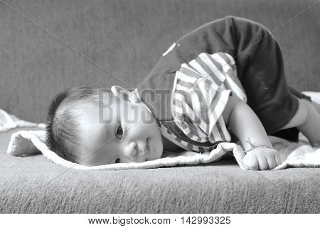 Little baby boyportrait of adorable curious smile baby boy close up in black and white