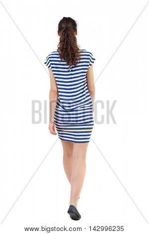 back view of walking  curly woman.  backside view of person.  Rear view people collection. Isolated over white background. Swarthy girl in a checkered dress is waving his hands