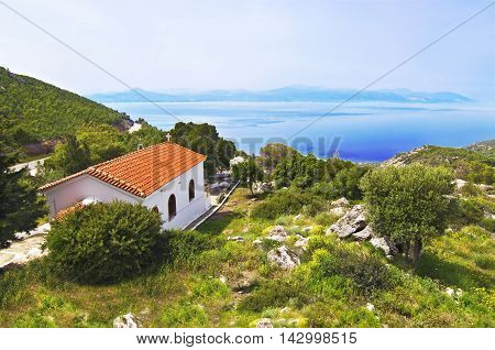 Orthodox chapel on mountain at Loutraki Greece and Corinthian Gulf