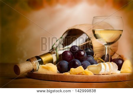 Gourmet food background border with wine cheese and grapes