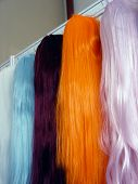 Detail of colors wig on the wall poster