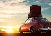 Retro red car with luggage on roof rack at sunset. Travel, vacation concepts. 3D illustration poster