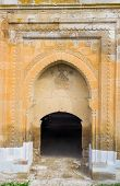 The stone gate of Agzikarahan Caravan Saray decorated with carved islamic patterns Agzikarahan Cappadocia Turkey. poster