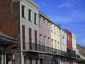 colorful and compact buildings in new orleans. poster
