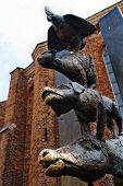 Sculprture of Bremen musicians: donkey dog cat and in Riga Latvia poster