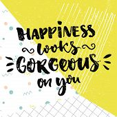 Happiness looks gorgeous on you. Inspirational quote and kind wish. Vector calligraphy design on colorful background with green, dots and squared paper. poster