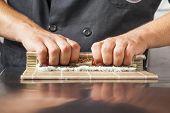 Sushi master turns sushi rolls  poster