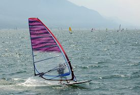 A wind surfer on the Lake Garda (Italy).