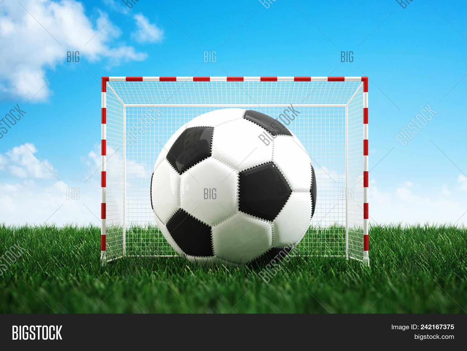 99baa3887 Large soccer ball filling small goalposts on fresh green grass on a sports  field against a