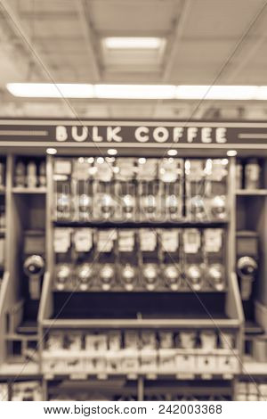 Vintage Blurred Row Of Variety Organic Raw Coffee Beans In Vending Machine At Grocery Houston Texas Us Bulk Container Next To Grinder