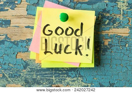 Good Luck Text Written On Sticky Note On Rustic Wooden Background. Motivational Quotes