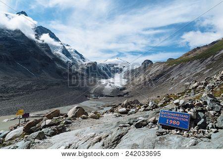 Sign Indicating The Retreat Of Grossglockner Glacier From 1980. Glacier Position 1980