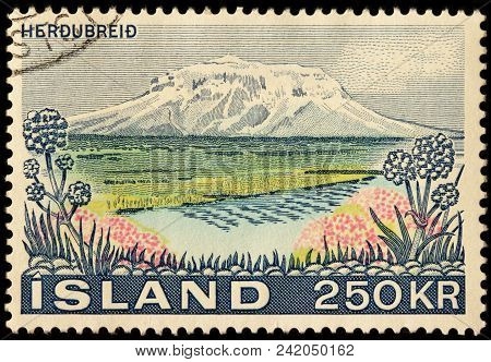 Luga, Russia - January 16, 2018: A Stamp Printed By Iceland Shows Beautiful View Of Tuya Herdubreid