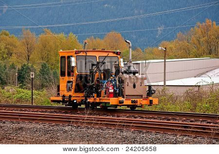 Machinery Work On Railroad Tracks