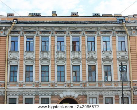 Classic Building Facade Architecture Of Old Historic House With Vivid Brown Colored Walls. Exterior