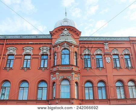 Classic Architecture Building Ornamental Facade Of Old Historical House With Sculptures And Red Colo