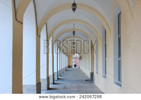 Outdoor Building Architecture Arch Passage, Straight Long Gallery Corridor. Perspective View Of Arch