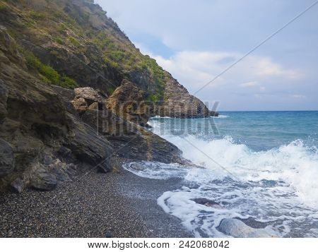 Sunny Beach With Sea Waves At Capo Calava, Italy