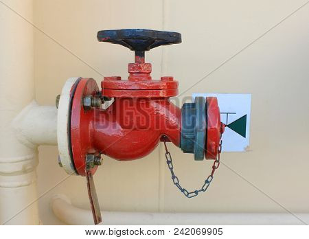 Valve Fire Caution Equipment Isolated Close Up View. Industrial Fire Fighting System That Regulates,