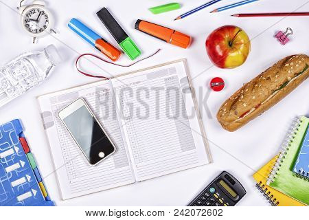 Back To School Concept. School Schedule. The Female Hand Fills The School Timetable. School Snack. T