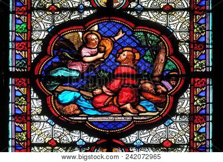 PARIS, FRANCE - JANUARY 05: Agony in the Garden, Jesus in the Garden of Olives, stained glass window in the Basilica of Saint Clotilde in Paris, France on January 05, 2018.