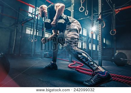 Fit Young Man Lifting Barbells Working Out At A Gym. Sport, Fitness, Weightlifting, Bodybuilding, Tr