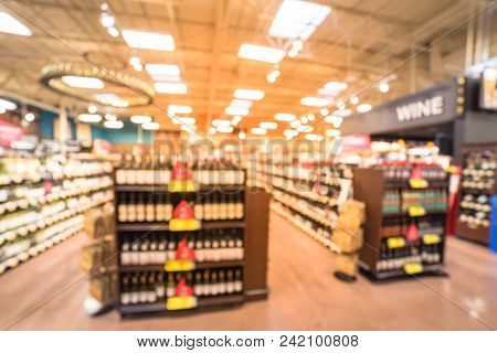 Abstract Blurred Wine Shelves With Price Tags At Store In Usa
