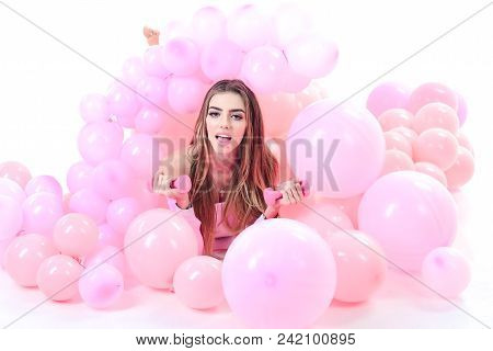 Young Woman Laying In Pink Balloon. Girl With Colorful Balloons. Sport Concept. Girl With Dumbbells.