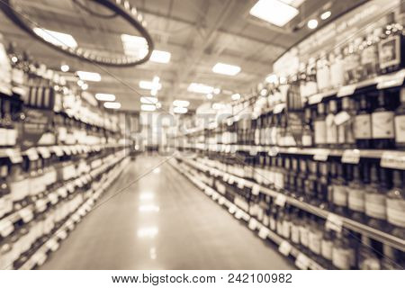 Vintage Blurred Wine Shelves With Price Tags At Store In Usa