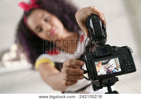 Black Girl At Home Talking In Front Of Camera, Setting Up Microphone For Recording Vlog At Home. You