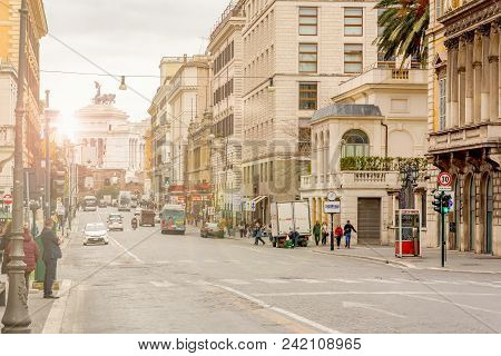 Rome, Italy, March 2017: View Of Via Nazionale In Rome With The Monument Of The Fatherland In The Ba