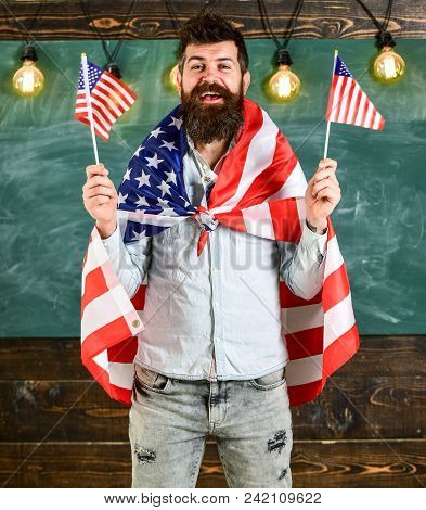American Teacher Waves With American Flags. Student Exchange Program. Patriotic Education Concept. M