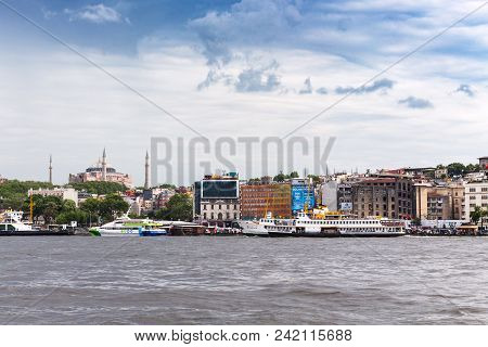 Istanbul, Turkey - May 11, 2018: Excursion Ships Near Waterfront Of Golden Horn Bay In Istanbul City
